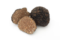 Sliced black truffles. Black truffles on a white background royalty free stock photos