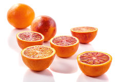 Sliced blood oranges. Arranged on white background. Selective focus Stock Photography