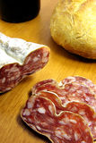 Sliced boloney, bread and wine Royalty Free Stock Photography