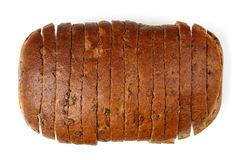 Sliced bread. A sliced loaf of whole-meal bread, isolated on a white background Stock Photos