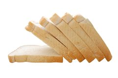 Sliced bread. Nutritious slices of white bread, isolated over white, macro, copyspace Royalty Free Stock Photo