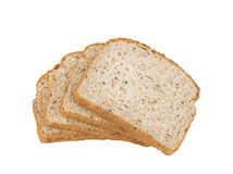Sliced Bread. Slices of wholegrain bread made with seeds and nuts isolated on white background Royalty Free Stock Images