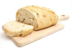 Sliced bread. Isolated shot of sliced bread on a cutting board on white Royalty Free Stock Image
