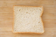 Sliced bread. Stack of sliced whole wheat bread on  wood background Royalty Free Stock Image