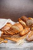Sliced bread. And wheat on the wooden table Stock Photos