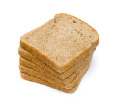 Sliced bread. Stack of sliced whole wheat bread on isolated white background Royalty Free Stock Images