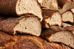 Sliced bread background. Fresh Italian ciabatta cut bread and crust background stock image