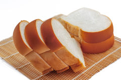 Sliced bread on a bamboo mat. Stock Images