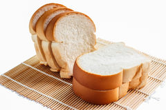 Sliced bread on a bamboo mat. Royalty Free Stock Images