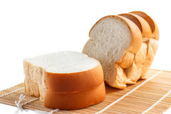 Sliced bread on a bamboo mat. Stock Photo