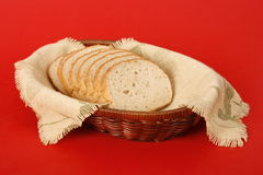Sliced Bread in a Basket. Against a red background Stock Photo