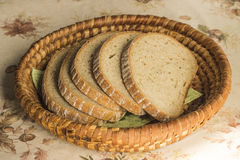 Sliced bread. In a basket royalty free stock image