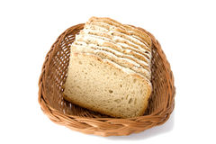 Sliced bread in basket on white Royalty Free Stock Photo