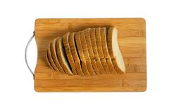 Sliced bread on a board. Stock Image