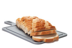 Sliced bread on breadboard Stock Images