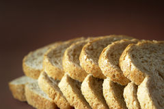 Sliced Bread. On brown background Royalty Free Stock Photography
