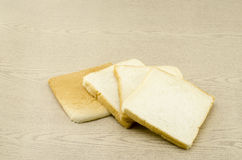 Sliced bread on brown wood Royalty Free Stock Image