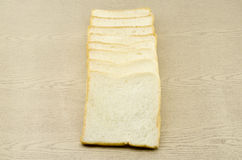 Sliced bread on brown wood Royalty Free Stock Photo