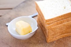 Sliced bread with butter on an outdoor setting. Royalty Free Stock Photo