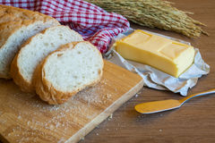 Sliced bread and butter on wood board Stock Image