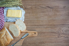 Sliced bread and butter on wood board Royalty Free Stock Photos