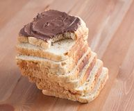 Sliced bread with chocolate on a wooden board Stock Photography