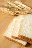 Sliced Bread. A closeup of some fresh baked bread that has been sliced on a wooden board royalty free stock images