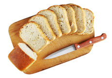 Sliced bread on a cutting board. Isolated over white Stock Photography