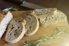 Pieces of bread, cutting board, Ciabatta, Healthy food,. Sliced bread on a cutting board. Ciabatta. Healthy food Stock Photos