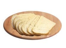 Sliced bread on cutting board isolated on white Stock Image