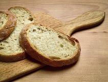 Sliced bread on a cutting board. Still life with sliced bread on a cutting board Stock Image