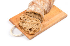 Sliced bread on cutting board. On white background Stock Photos