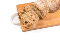 Sliced bread on cutting board. On white background Stock Image