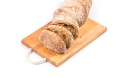 Sliced bread on cutting board Royalty Free Stock Photos