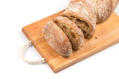 Sliced bread on cutting board Stock Photography