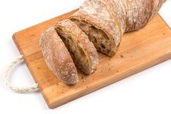 Sliced bread on cutting board Stock Photos