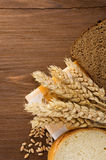 Sliced bread and ears of wheat Stock Photography