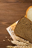 Sliced bread and ears of wheat Royalty Free Stock Photography