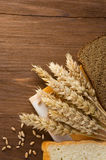 Sliced bread and ears of wheat Royalty Free Stock Photo