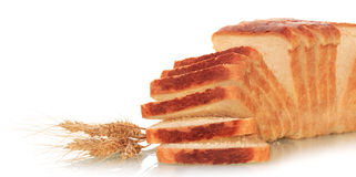 Sliced bread and ears of wheat Royalty Free Stock Photos