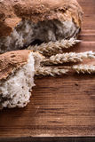 Sliced bread eras of rye on vintage wooden board Royalty Free Stock Photos
