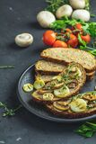 Sliced bread with fried cutting mushroom champignon and onion. Delicious homemade whole grain rye sliced bread toast with fried cutting mushroom champignon and stock image