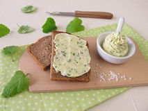 Sliced bread with herb butter Stock Photos