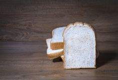 sliced bread isolated on a wood background Royalty Free Stock Photos