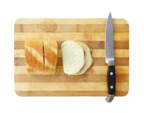 Sliced bread and kitchen knife on cutting board Royalty Free Stock Photos