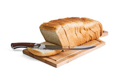 Sliced bread and knife Royalty Free Stock Photos