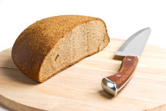 Sliced bread and the knife Stock Image