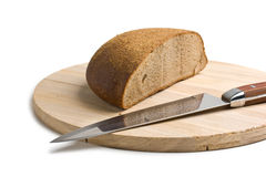 Sliced bread and the knife Stock Photography