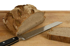 Sliced bread and knife Stock Images
