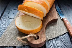 Sliced bread and a knife on a cutting board Stock Image